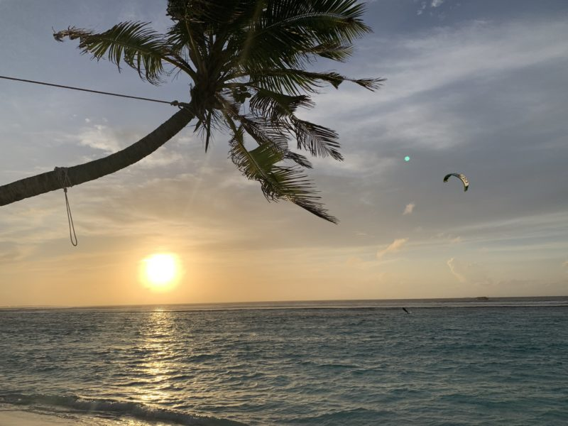Sunset with kitesurfer in Maldives