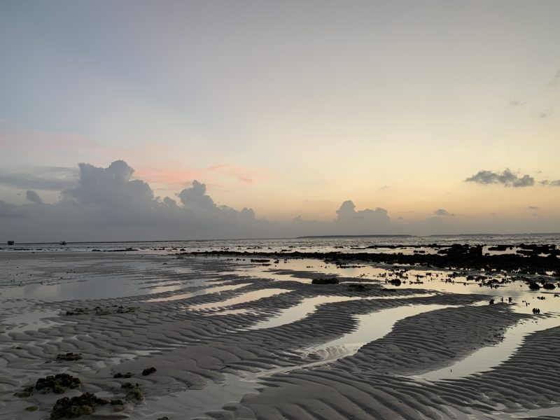 Sunset in low tide time in Maldives